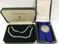 A Silver hallmark Choral Society medal together with a set of Pearls with a 9ct Gold clasp.