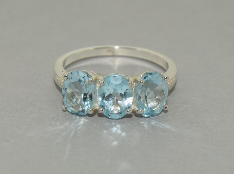 Large Ice Blue Topaz 925 Silver Trilogy Ring. Size Q1/2.