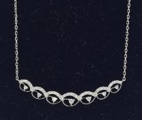 An 18ct white gold diamond necklace of 50points.