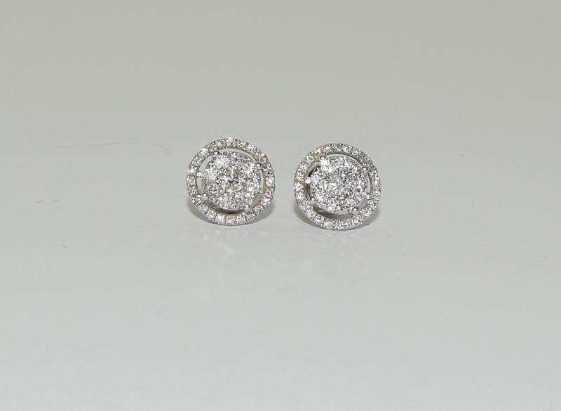 A pair of 0.66 carat diamond 18ct white gold Halo stud Earrings. - Image 3 of 5
