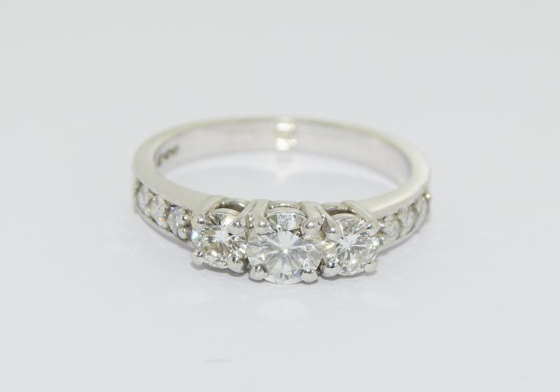 Moissanite 3 stone approx 0.5 points and sidestone set in 9ct White Gold ring in original box.