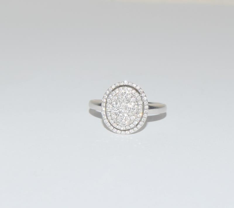 18ct White Gold ladies Diamond Halo set ring. Size O.