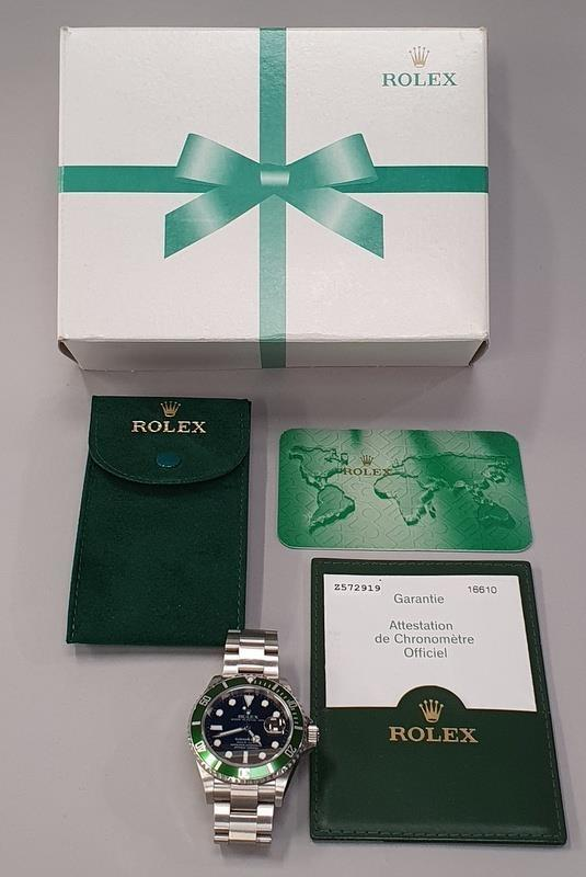Rolex Submariner 16610, with service box and papers.