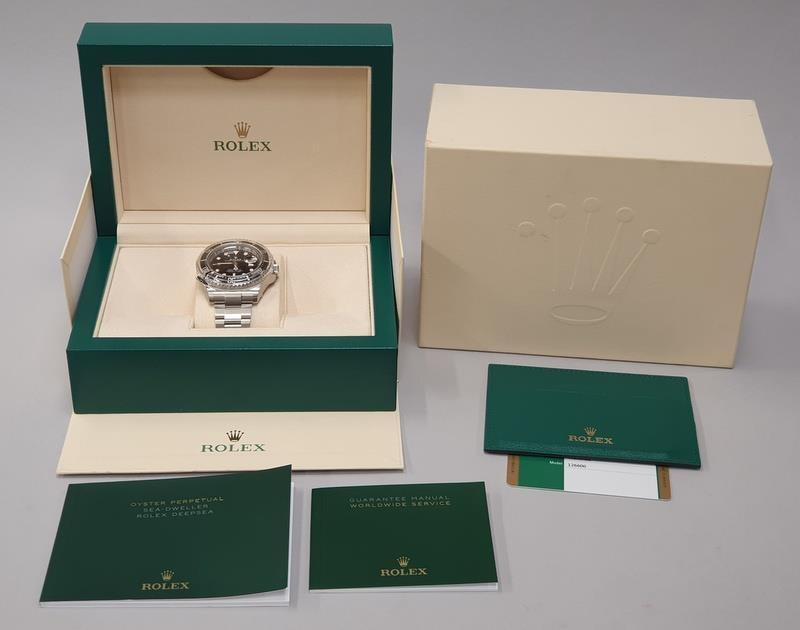 Rolex Anniversary Red Sea Dweller, boxed and papers, unworn with stickers.