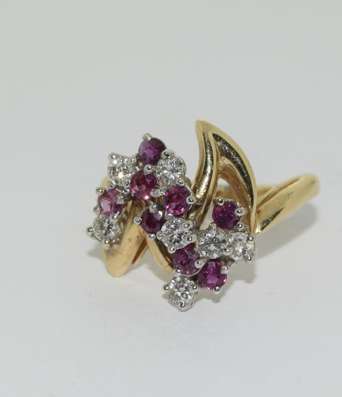 A 14ct yellow gold ruby and diamond ring in the Art Deco style. Size P