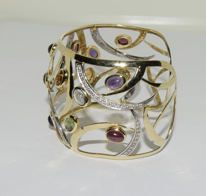 A 14ct yellow gold bangle set with diamonds, citrines, peridot etc. - Image 4 of 5