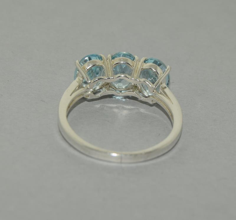 Large Ice Blue Topaz 925 Silver Trilogy Ring. Size Q1/2. - Image 5 of 5