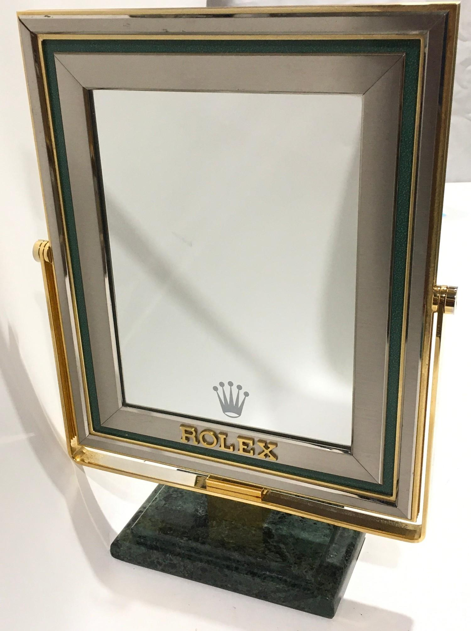 Genuine Rolex onyx based vanity mirror. 38cm tall, 27cm wide