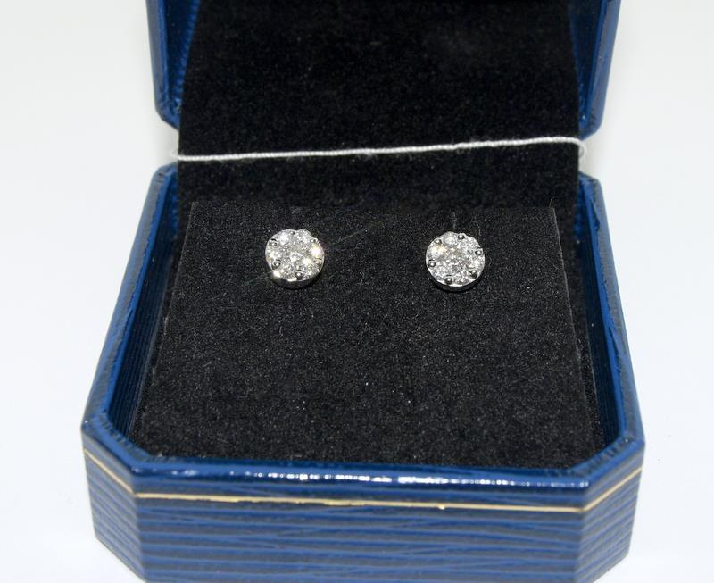 A pair of 18ct white gold stud earrings of 50 points.
