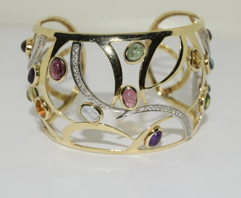 A 14ct yellow gold bangle set with diamonds, citrines, peridot etc. - Image 5 of 5