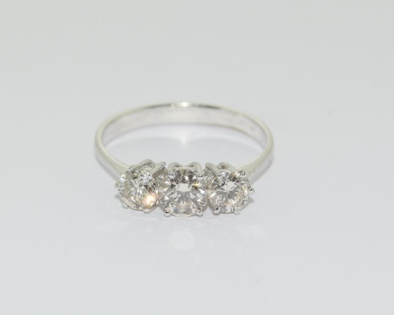 An 18ct white gold three stone diamond ring of 1.1cts.