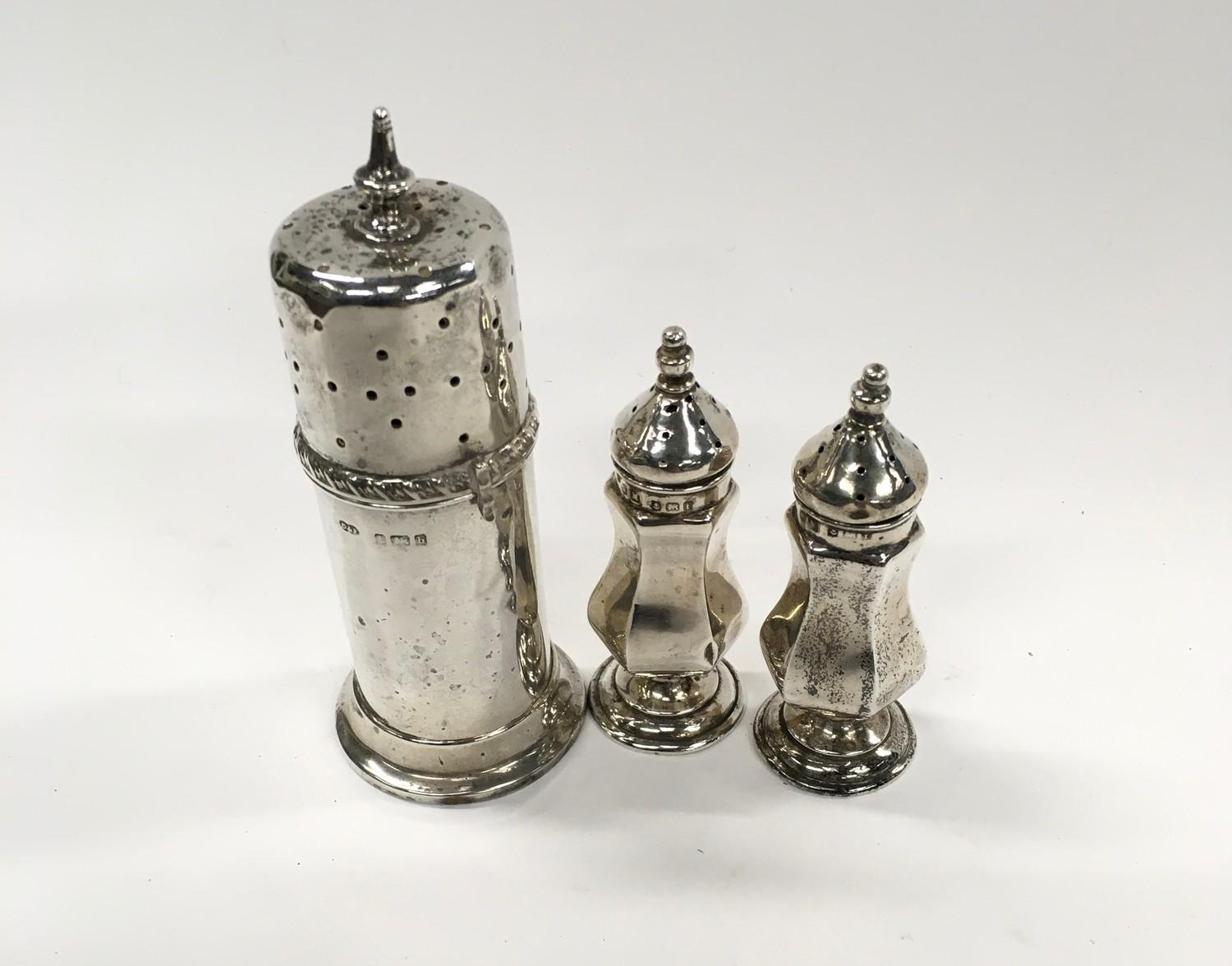 Silver Hallmarked 1901 Sugar Duster together with a Pair of Silver Hallmarked Peppers.