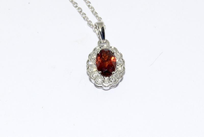 An 18ct white gold garnet and diamond pendant necklace. - Image 4 of 4