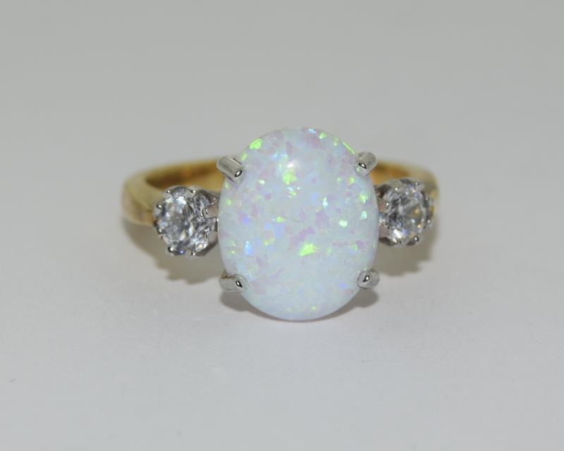 9ct Gold On Silver Opaline Trilogy ring.