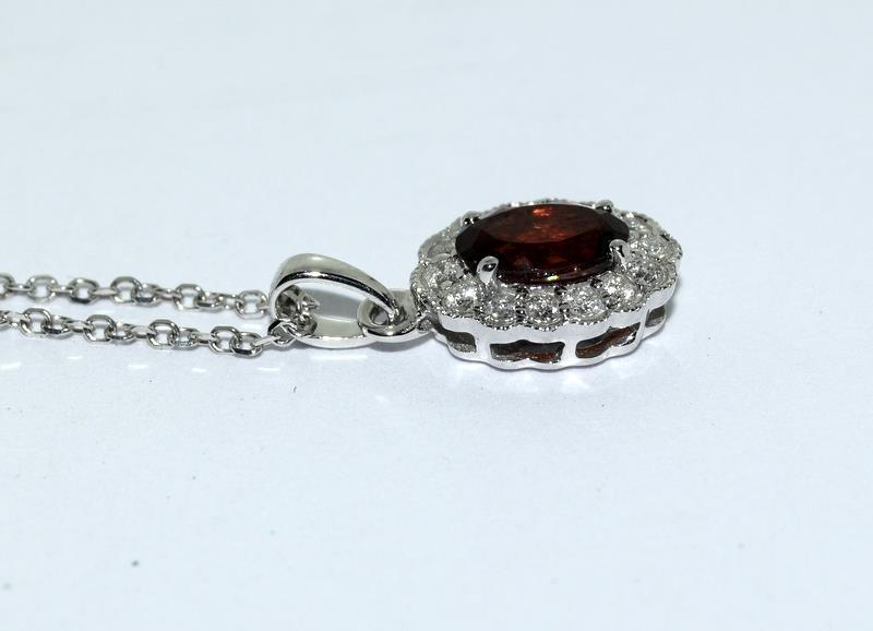 An 18ct white gold garnet and diamond pendant necklace. - Image 2 of 4