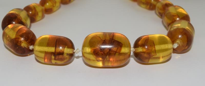 A pair of 1930-40 Amber necklaces. - Image 3 of 6