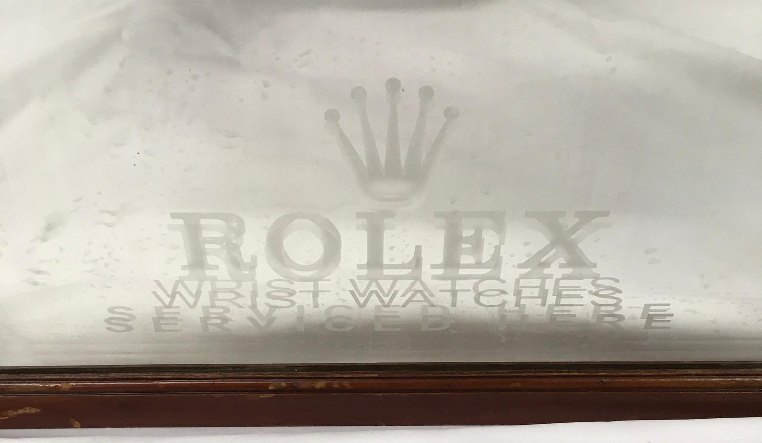 A wood framed and bevel edged mirror, etched Rolex. 80 cm by 53 cm - Image 2 of 2