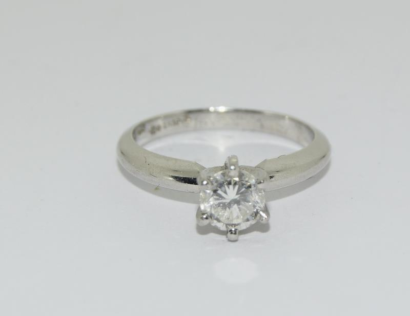 A Platinum set single stone ring of 65 points approx. Size L