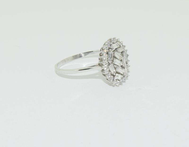 An 18ct white gold and Diamond Fancy Baguette and round cut abstract cluster ring, Size Q 1/2. - Image 4 of 5