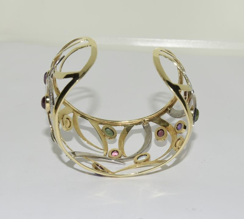 A 14ct yellow gold bangle set with diamonds, citrines, peridot etc. - Image 3 of 5