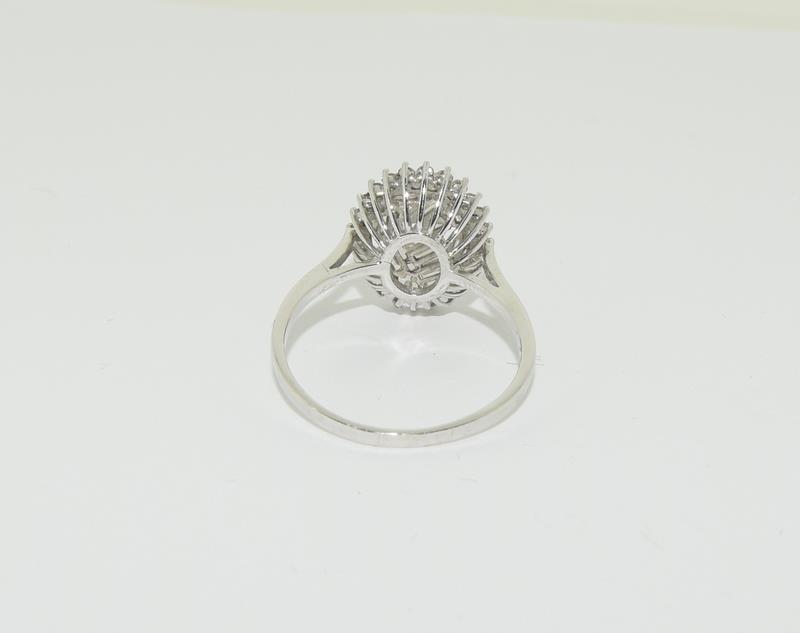 An 18ct white gold and Diamond Fancy Baguette and round cut abstract cluster ring, Size Q 1/2. - Image 3 of 5