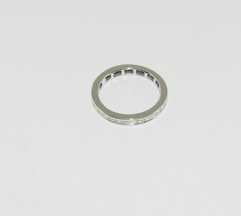 An 18ct white gold Princess cut Diamond 1.5ct full Diamond eternity band ring Size P 1/2. - Image 2 of 3