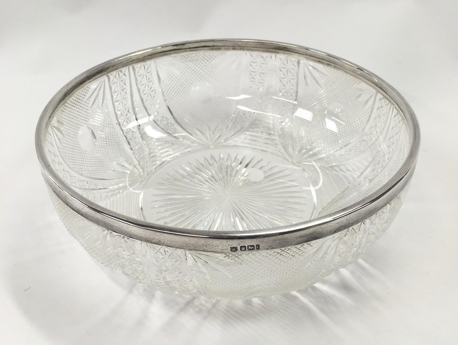 Cut glass bowl with silver rim.