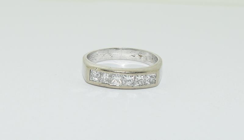 An 18ct white gold Princess cut half eternity band, Size Q, 6.7grams