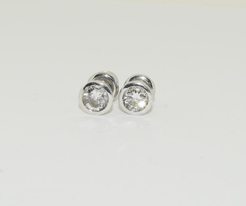 A pair of approx. 1 carat Diamond Solitaire studs in 18ct white gold. - Image 2 of 4