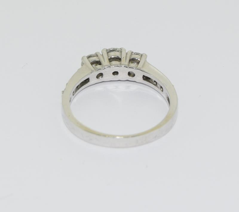 Moissanite 3 stone approx 0.5 points and sidestone set in 9ct White Gold ring in original box. - Image 3 of 5
