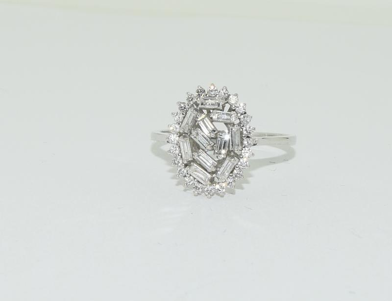 An 18ct white gold and Diamond Fancy Baguette and round cut abstract cluster ring, Size Q 1/2.