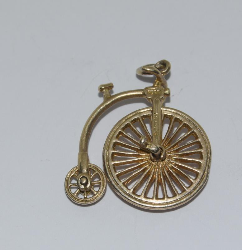 9Ct Gold Articulated Penny-farthing Charm. 20mm. 2.7g
