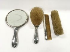 Four piece Silver dressing table set.