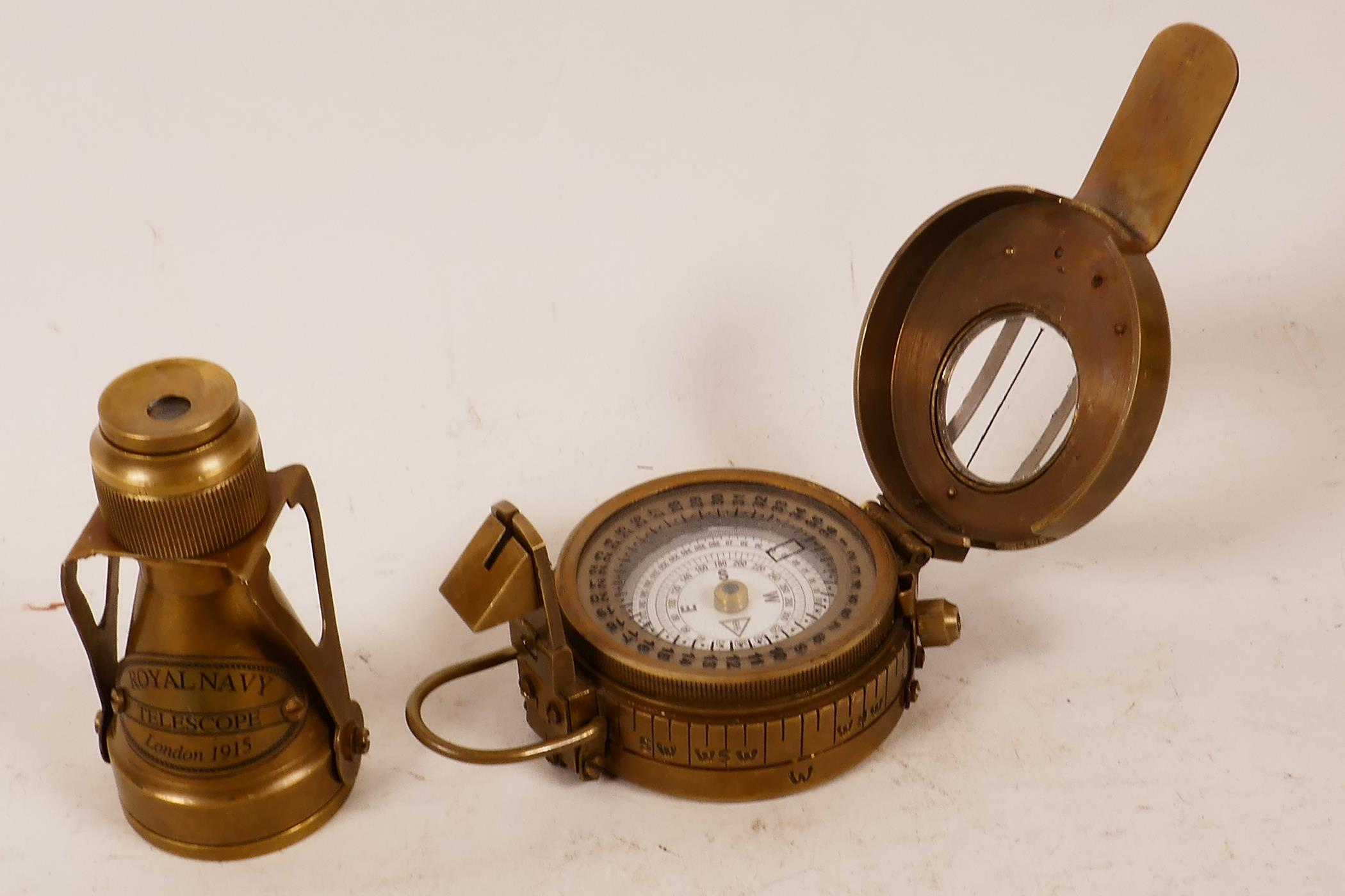 """Lot 4 - A replica brass military sighting compass and small brass telescope, 3"""""""