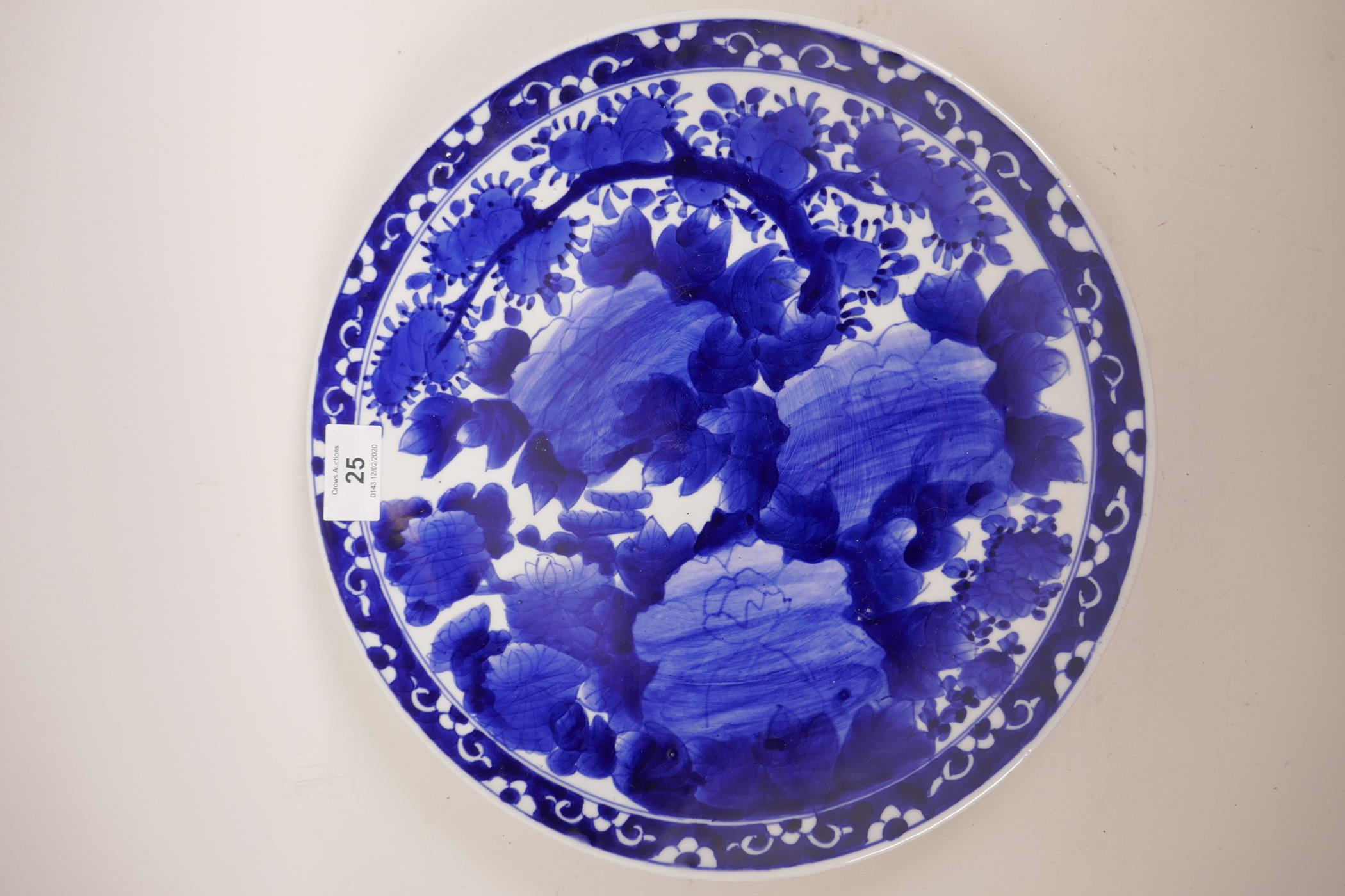 "Lot 25 - An Oriental blue and white decorative plate, with red seal imprinted to base, 12"" diameter"