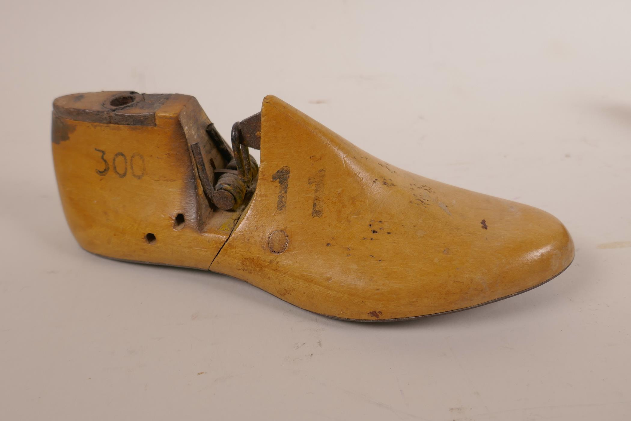 Lot 18 - Two mid-Victorian hinged wooden shoe lasts; one lady's right foot with pointed toe, and one child'