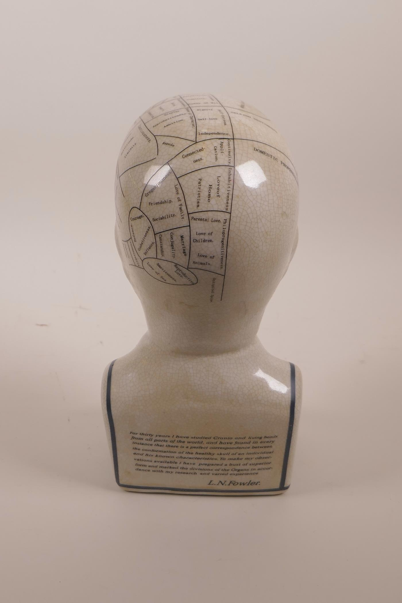 "Lot 6 - A pottery phrenology head with crackle glaze, 9½"" high"