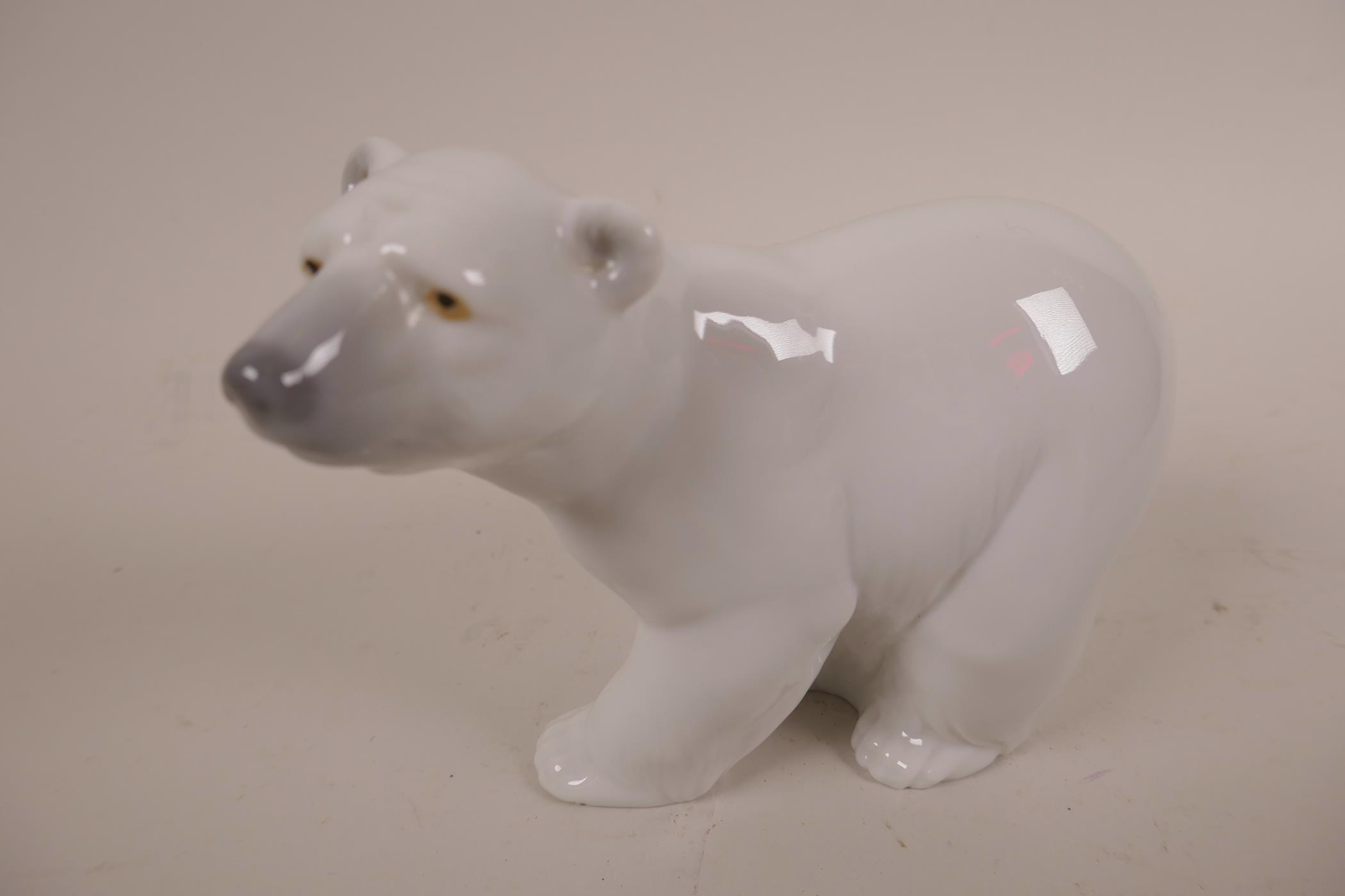 Lot 10 - Two Lladro polar bear figurines; 'Resting Polar Bear' and 'Attentive Polar Bear', stamped to base