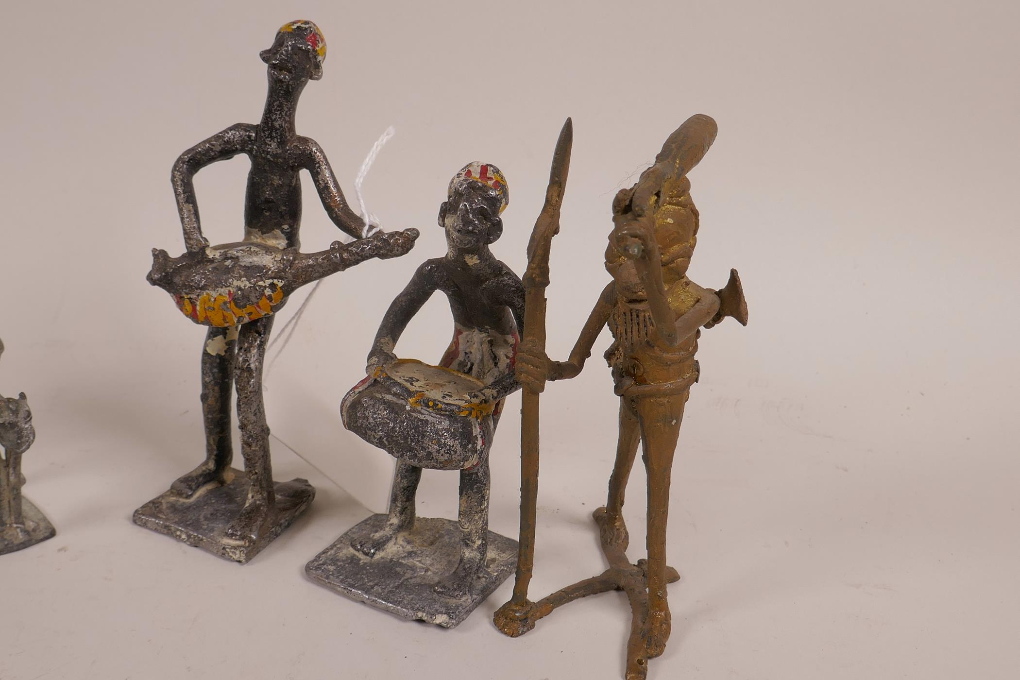 Lot 30 - An African Benin brass figure of a hunter, together with another small Benin bronze of a figure on