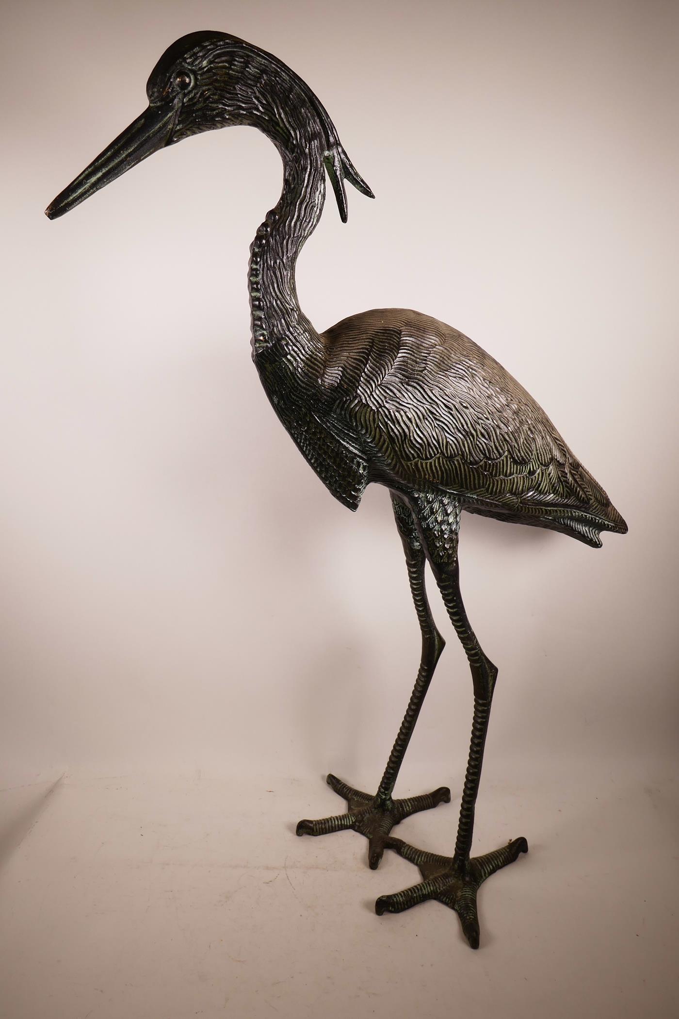 """Lot 1 - A metal garden figure of a heron, 33½"""" high"""