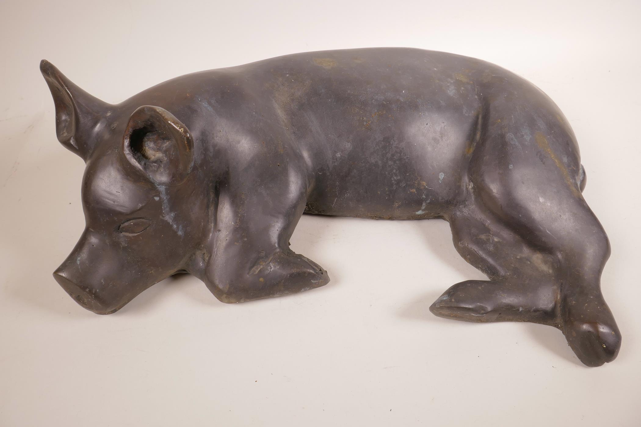 "Lot 31 - A large bronze recumbent pig, 18½"" x 14"""