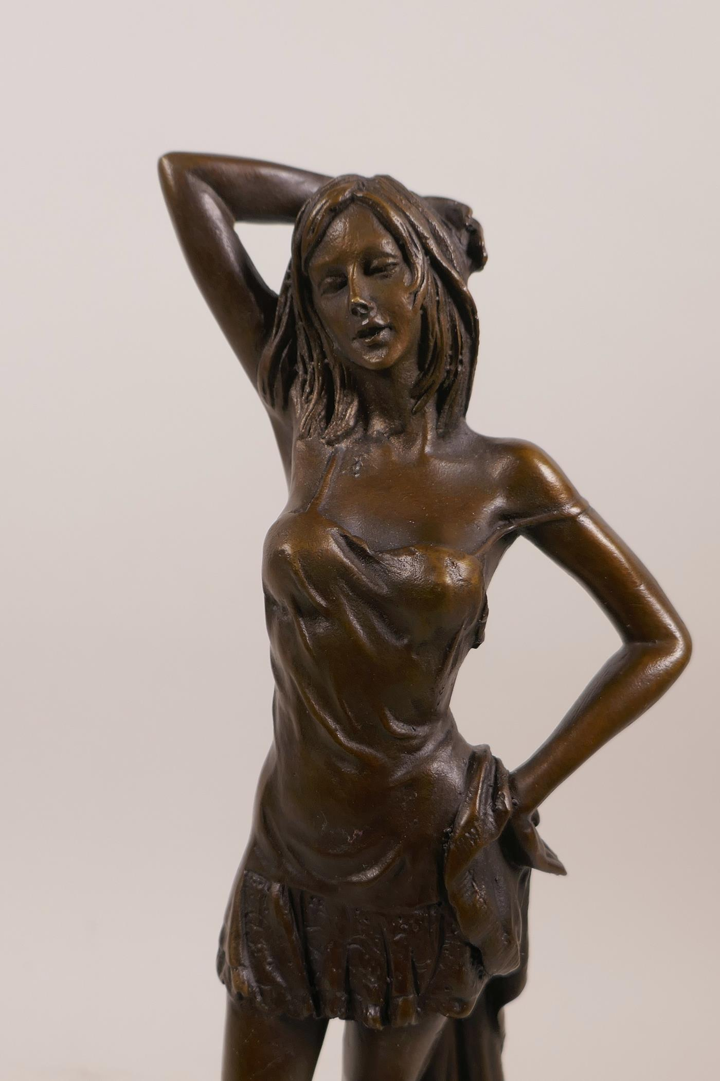 "Lot 8 - After Luis Noee, a bronze figure of a young woman, mounted on a marble base, 11"" high"