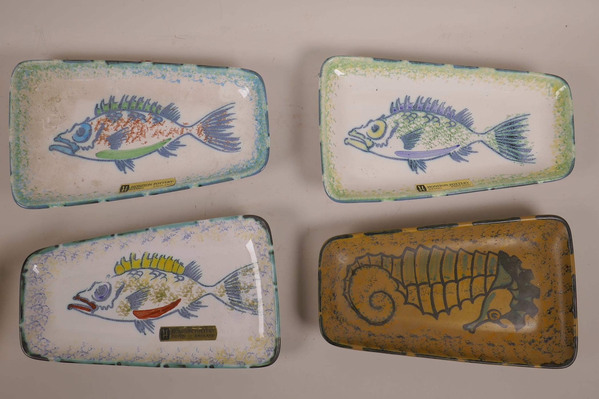"Lot 15 - A set of four Honiton pottery fish plates, mark to base, 10"" x 6"""