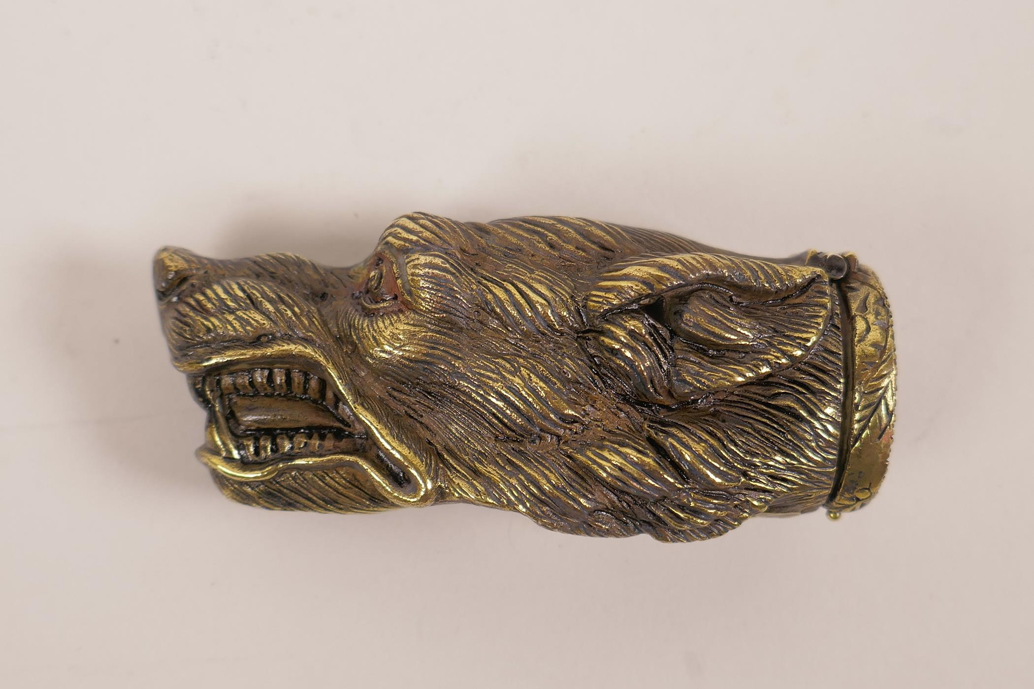 "Lot 29 - A brass vesta case shaped as the head of a snarling dog, 13"" long"