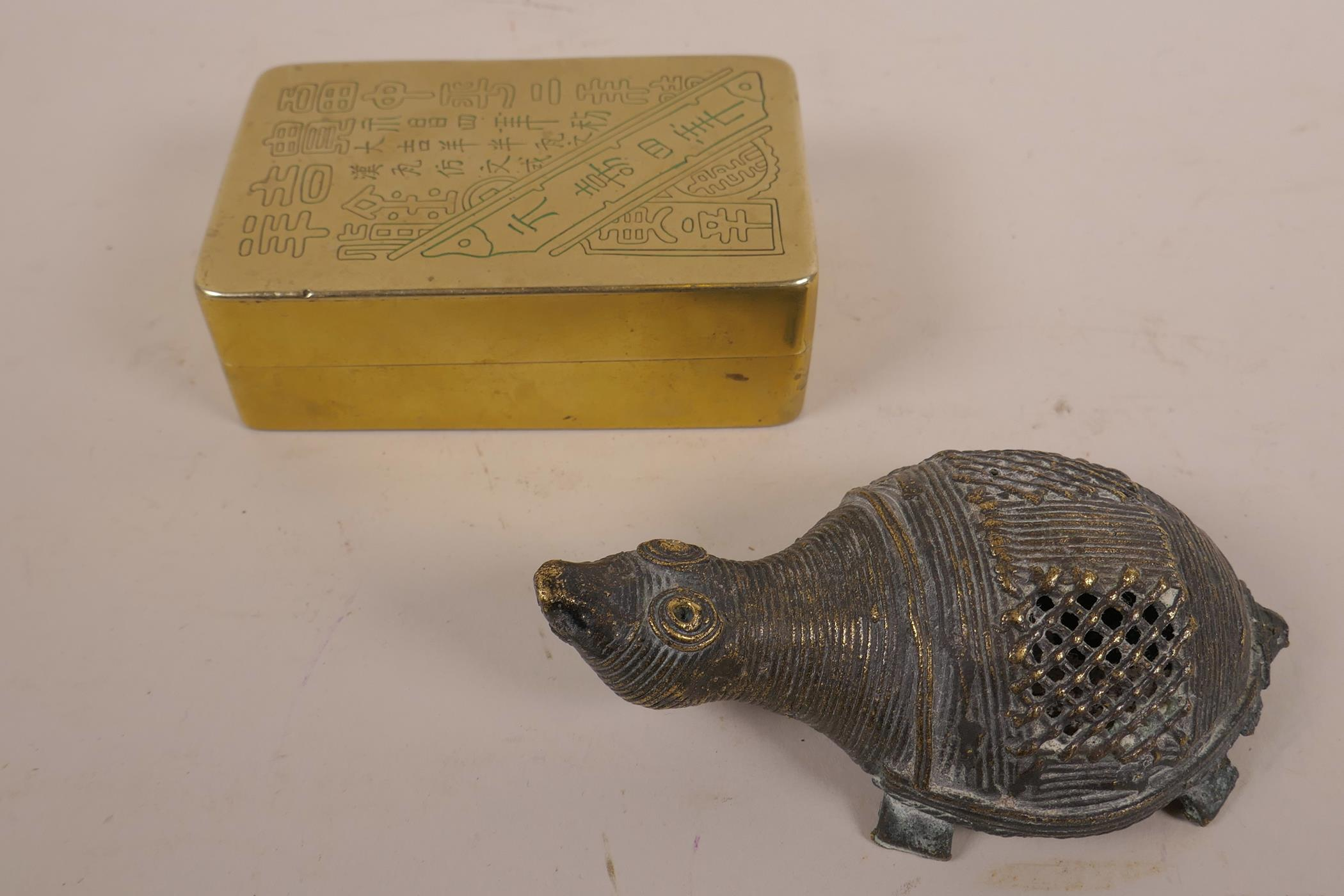 Lot 21 - A Chinese brass box, engraved with Chinese calligraphy and internally lined with copper (and