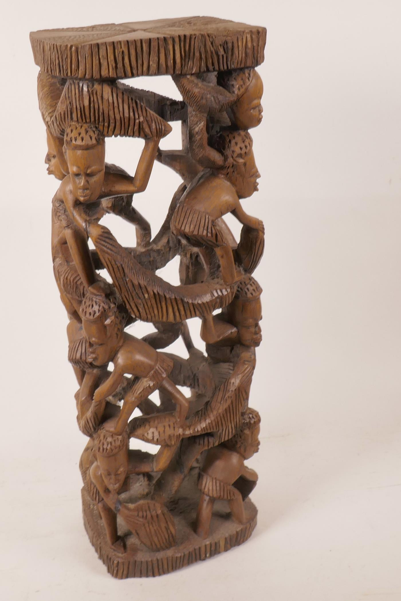 """Lot 2 - An African hardwood lamp base carved as a tower of figures, 18½"""" high"""