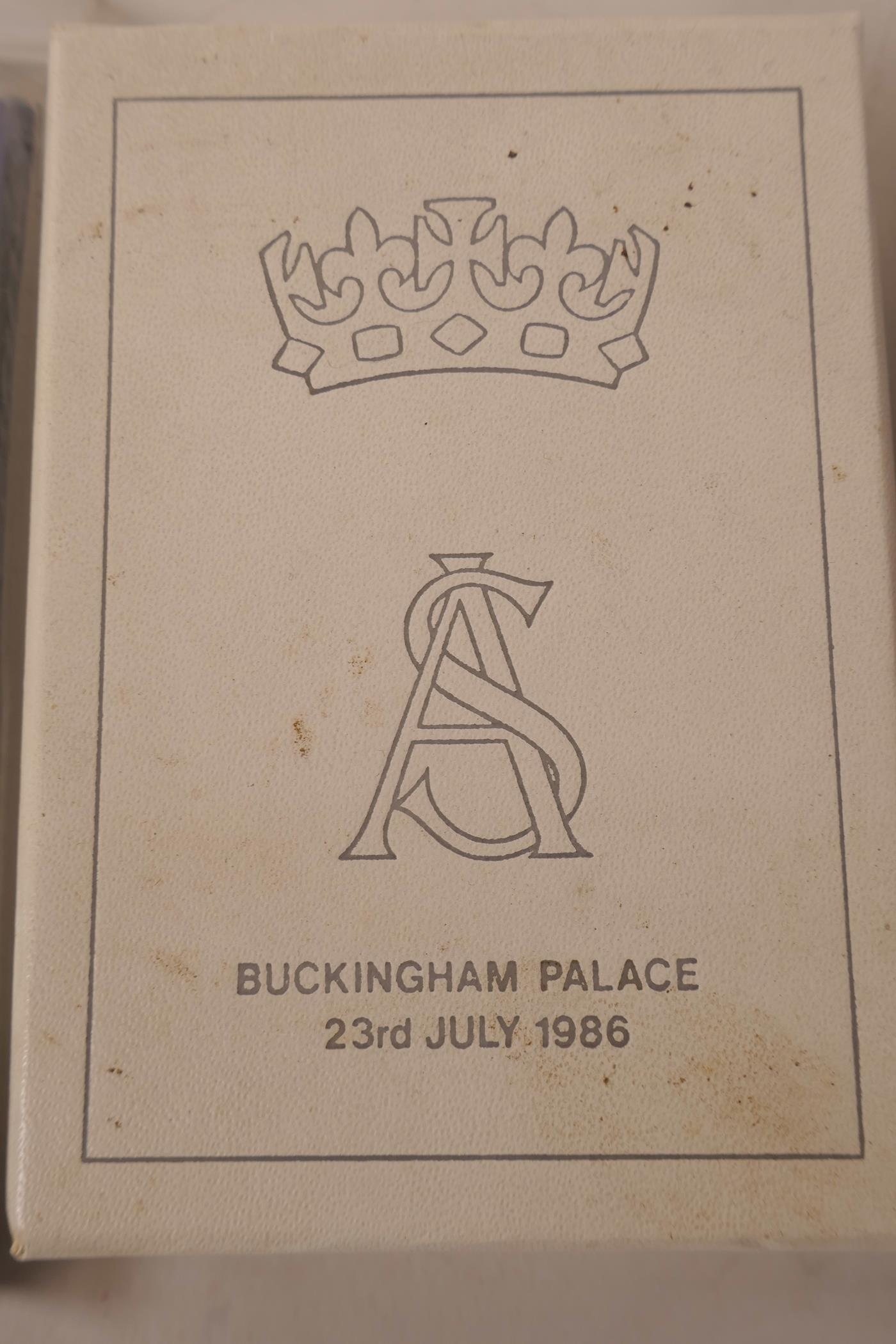 Lot 52 - Royal memorabilia, a boxed slice of cake from the wedding of Prince Andrew and Sarah Ferguson,