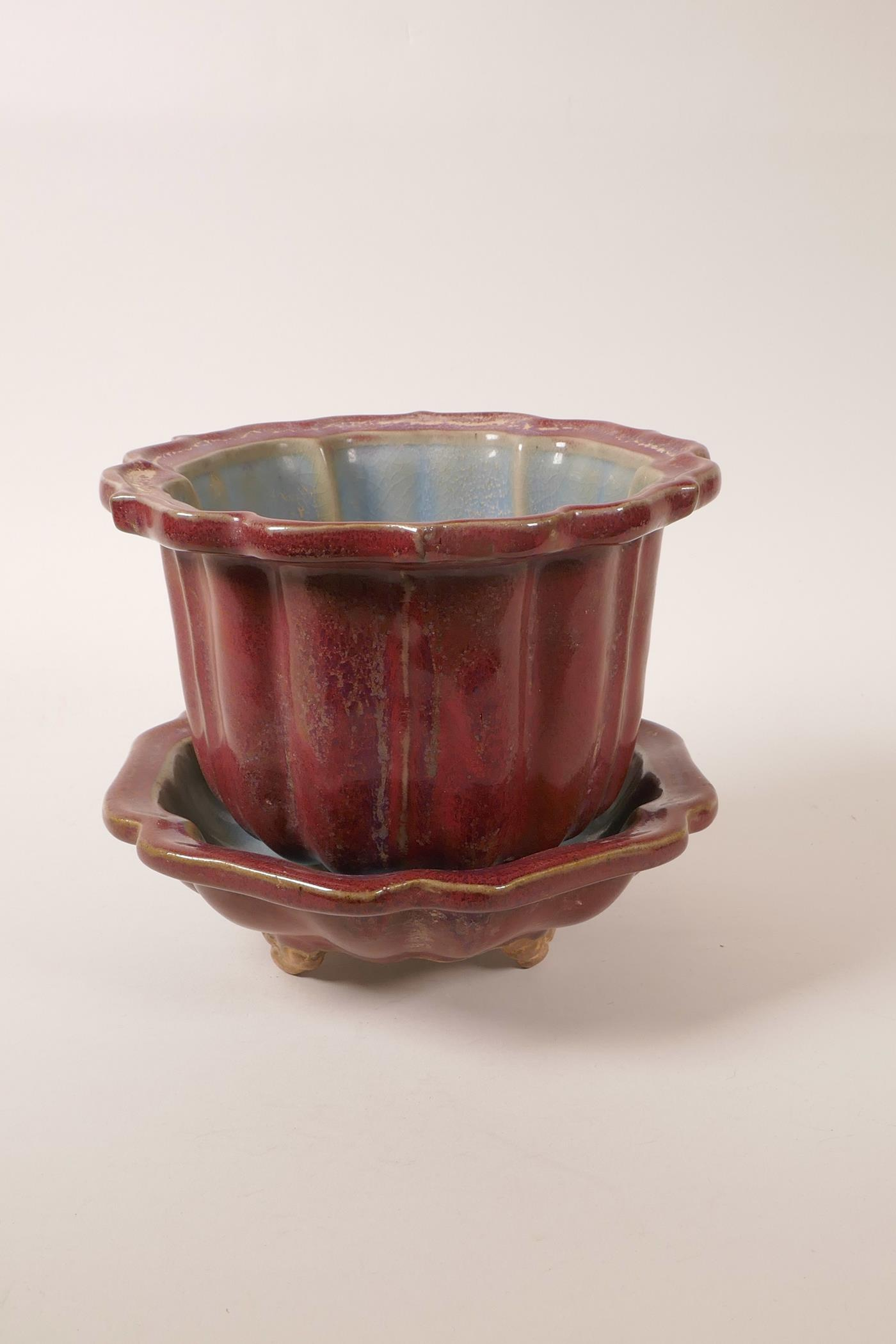 """Lot 48 - A Chinese Jun ware pottery planter and matching stand, both of lobed form, 7½"""" high x 6½"""" diameter"""