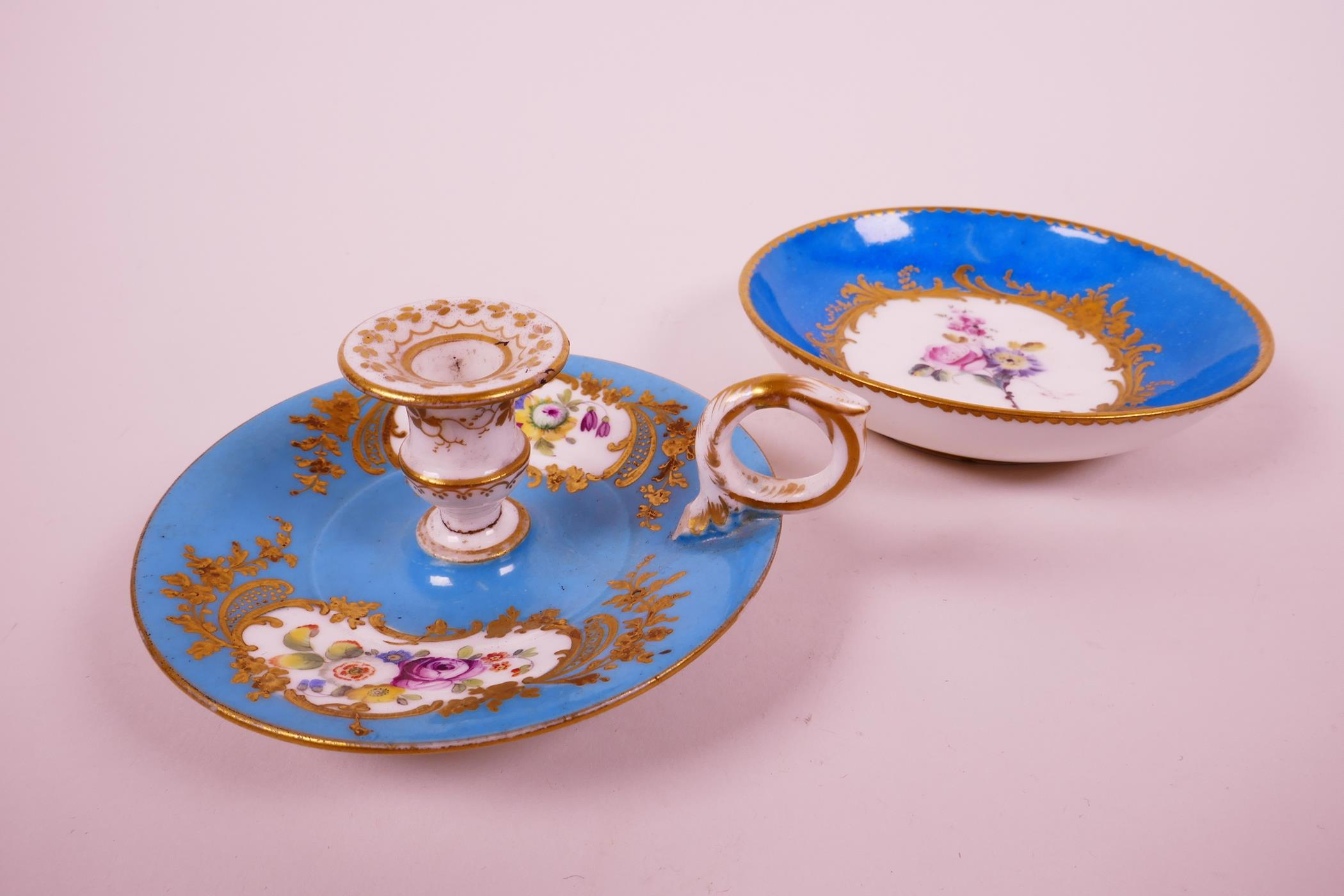Lot 22 - A C18th Sevres bleu celeste (turquoise blue) ground chamberstick, hand painted with polychrome
