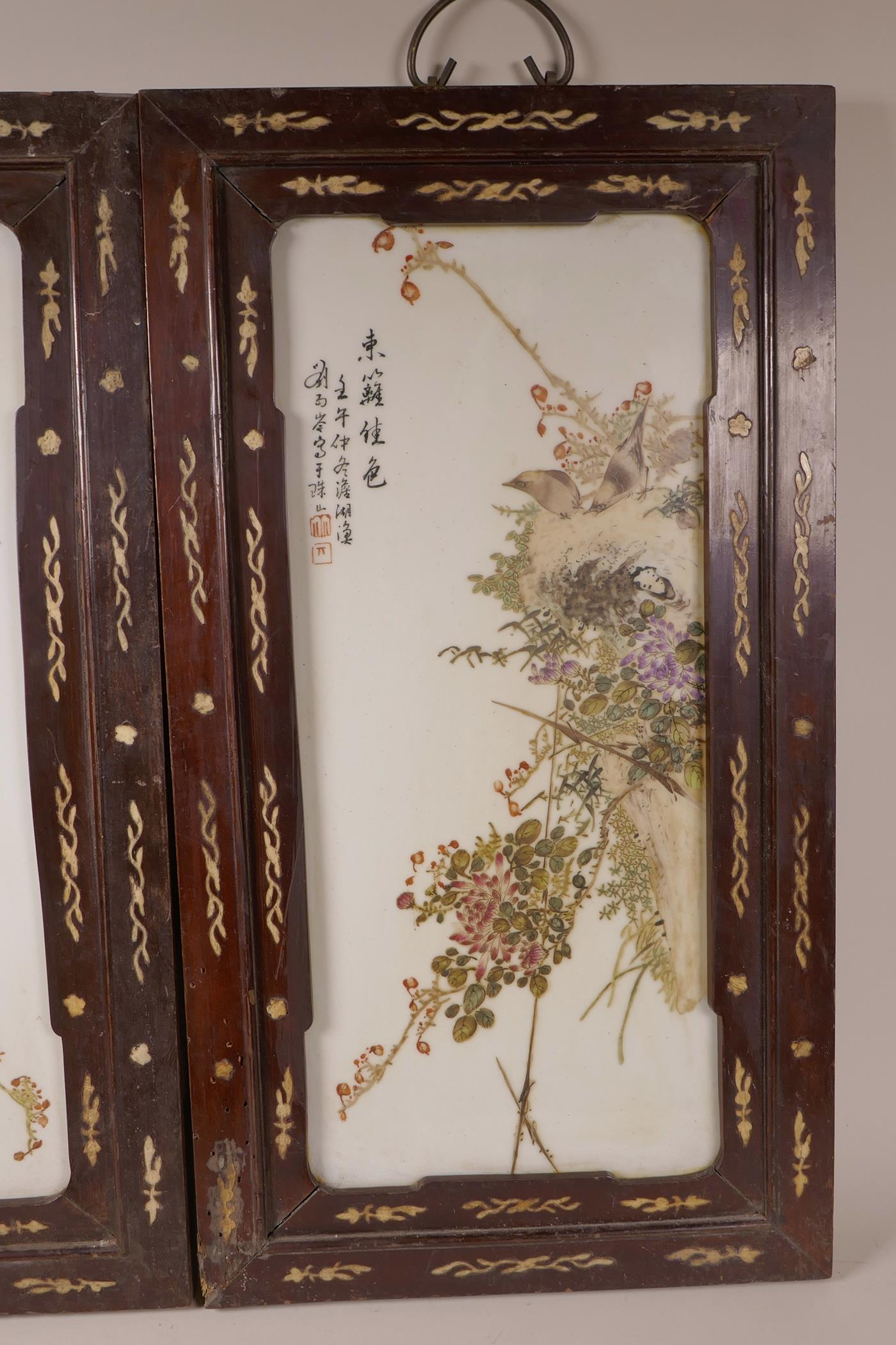 Lot 60 - A pair of Chinese polychrome porcelain panels decorated with birds amongst flowers, mounted in